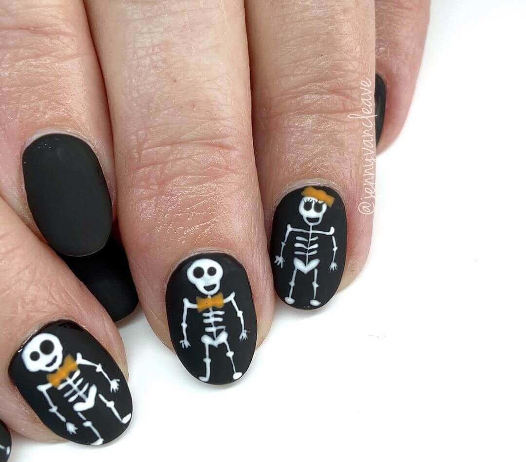 design des ongles de squelette pour halloween