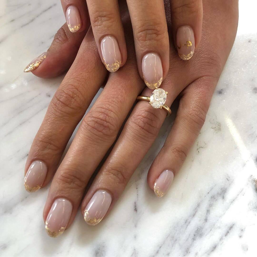 ongles français dorés pour la mariée